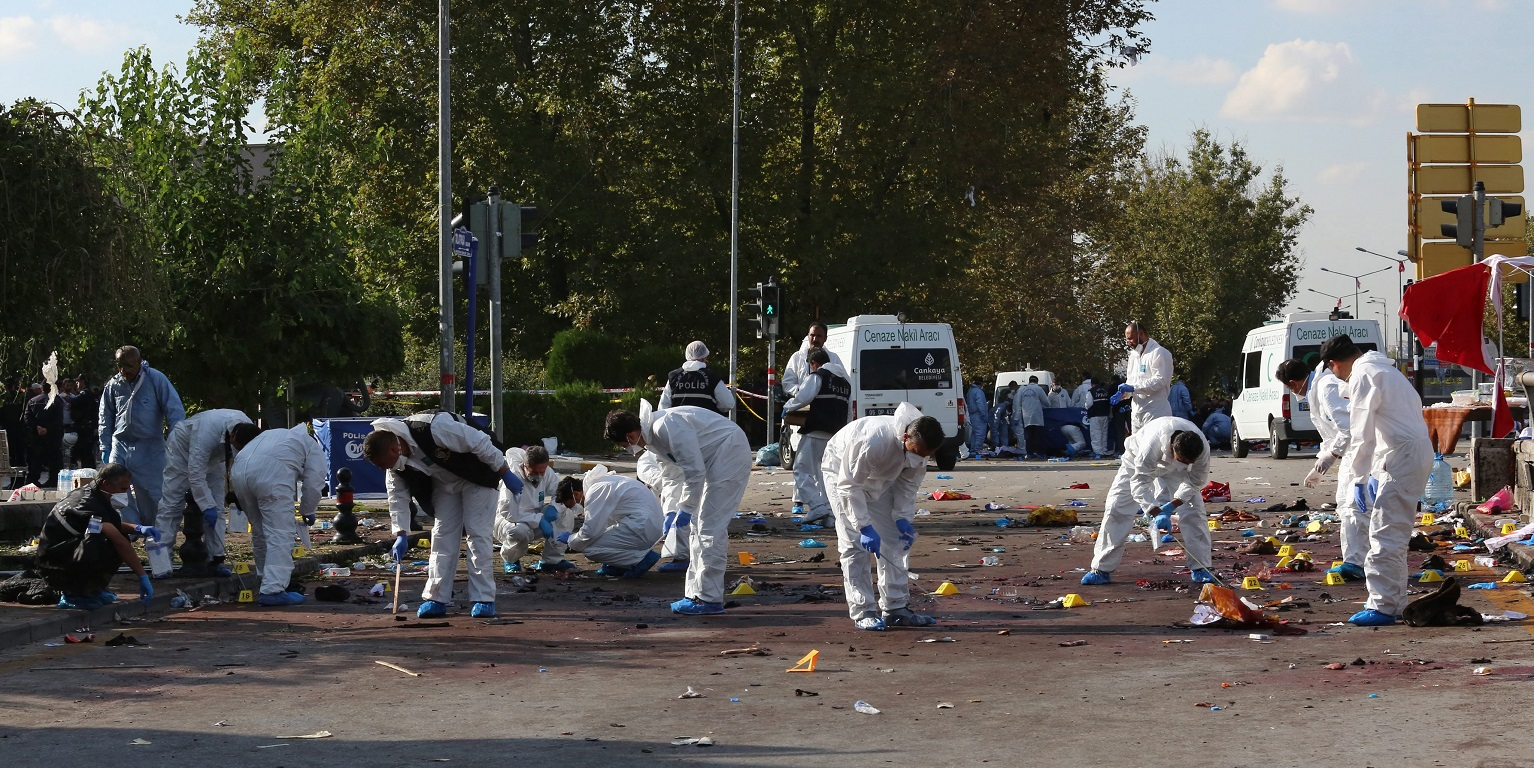 epaselect epa04971982 Forensic teams of the police investigate the area after multiple explosions ahead of a rally in Ankara, Turkey, 10 October 2015. Twin bomb blasts on 10 October killed 86 people gathering for a pro-Kurdish peace rally in the Turkish capital, Ankara, in the worst attack in Turkey's modern history. No group has claimed responsibility for the attack, which comes just three weeks before snap general elections set for 01 November and the G20 heads-of-government summit later next month, raising security concerns.  EPA/STR