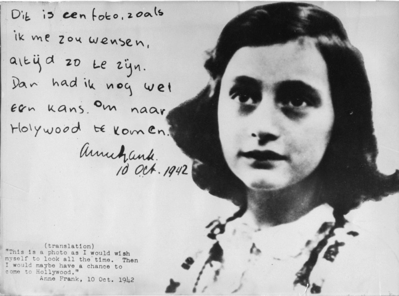 """This image shows Anne Frank,  with a hand written note and signed by her in Dutch language dating back to October 10, 1942. The note says: """"This is a photo as I would wish myself to look all the time. Then I would maybe have the chance to come to Hollywood."""" signed: Anne Frank 10 Oct. 1942. Anne Frank, is the Jewish girl who wrote her world famous journal while living in hiding, in Amsterdam, Netherlands, during the Second World War. (AP Photo)"""