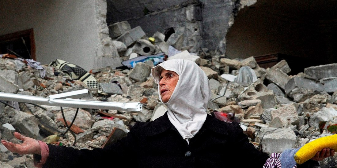 FILE - In this Wednesday, Feb. 6, 2013 file photo, a Syrian woman stands amid the ruins of her house which was destroyed in an airstrike by government warplanes a few days earlier, killing 11 members of her family, in the neighborhood of Ansari, Aleppo, Syria. President Bashar Assad has exploited his greatest advantage on the battlefield _ his air power _ to push back rebel advances and prevent the opposition from setting up a rival government in its northern stronghold. Along the way, fighter jets and helicopters bombed bakeries, makeshift hospitals and residential areas, according to a new report by a U.S.-based rights group released Thursday, April 11, 2013 accusing the regime of committing war crimes with indiscriminate airstrikes that have killed more than 4000 since summer. (AP Photo/Abdullah al-Yassin, File)